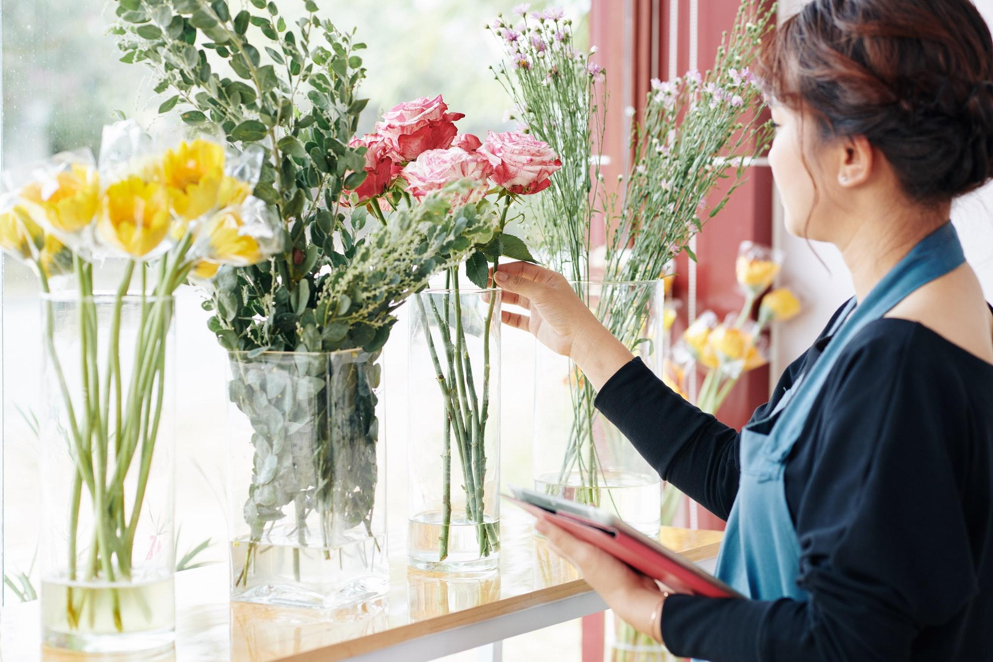 Florist showing flowers for bouquet